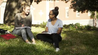 two girls laughing and talking on the college campus 4k