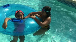 Two Little Girls Playing In A Swimming Pool 4 K