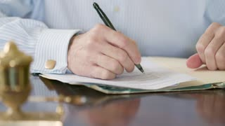 wide shot businessman writing on a legal document