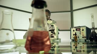 wide shot laboratory scientist looking in a microscope 4k