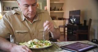 Wide Shot Man Eating Healthy Salad In His Home