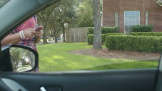 Woman ride sharing customer talks to driver through car window