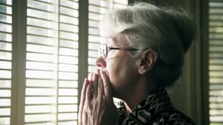 worried older woman thinking about something 4k