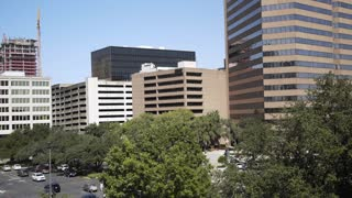 view of office buildings from the top of a parking garage 4k