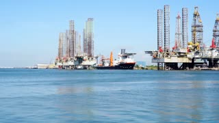 view of oil rigs and jackup barges in Galveston bay
