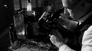 vintage scientist looking through microscope 4k.