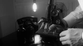 vintage scientist using a microscope 4k
