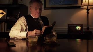 vintage thirties scene man adjusts radio and reads book 4k