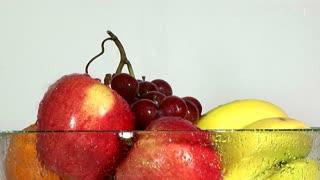 water falling on fruit