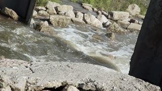 water streaming through a flood gate 4k