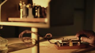 wide shot of telegrapher using a morse code key 4k