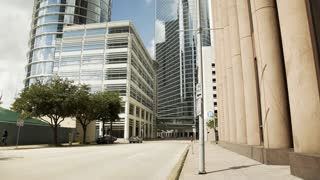 wide street view of highrise office buildings in downtown houston 4k