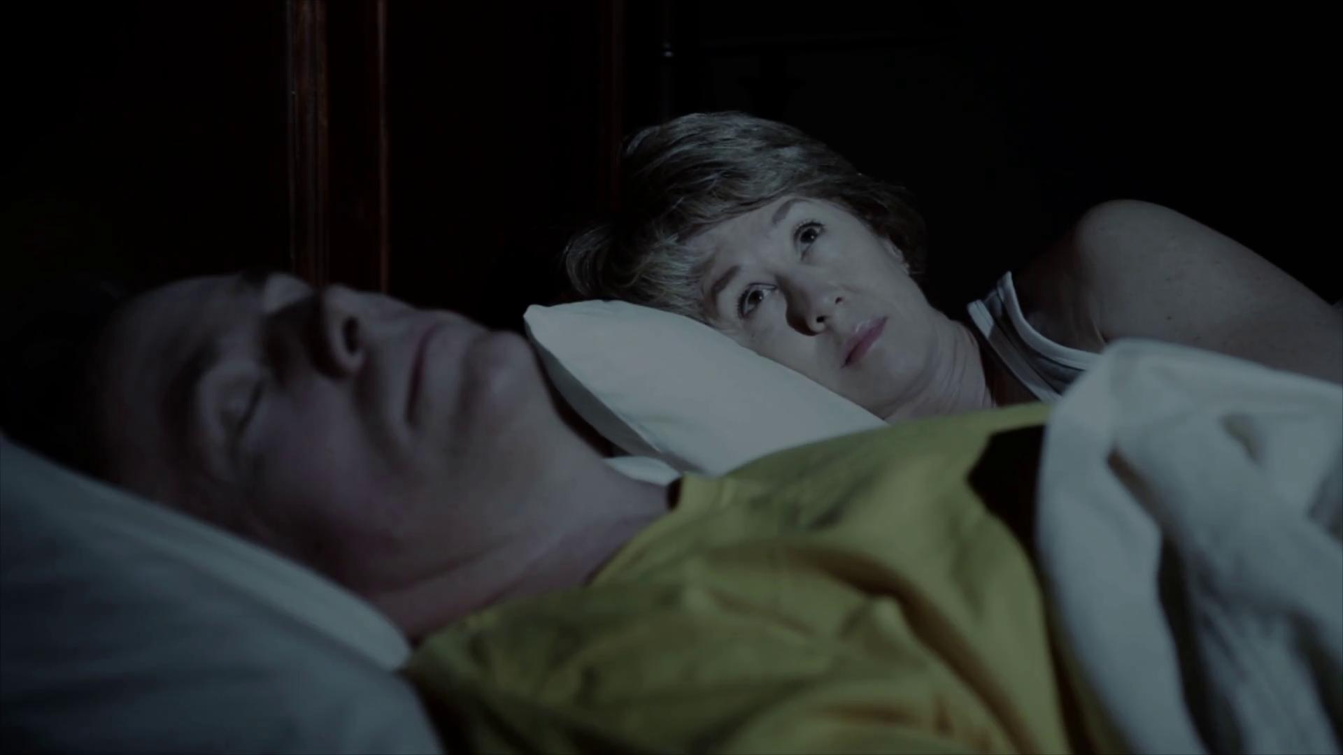 woman cant sleep while husband sleeps Stock Video Footage