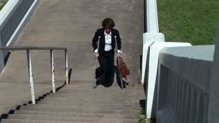 woman crutches stairs