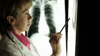 woman doctor looking at xray