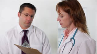 woman doctor taking notes from a paitent