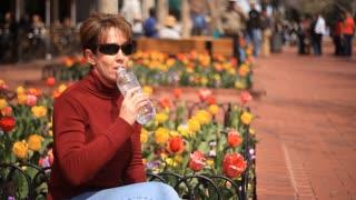 woman drinking water wide