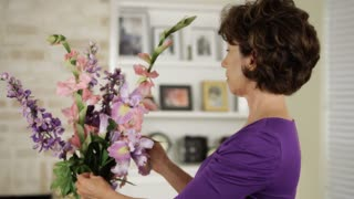 woman fixing flowers in her home