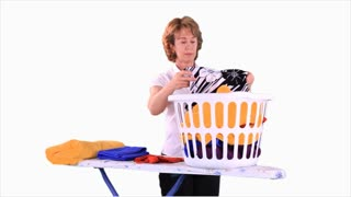 woman folding clothes close