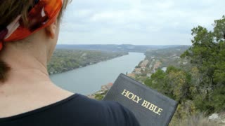 woman holding a Holy Bible