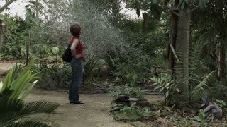 woman looking at a large garden