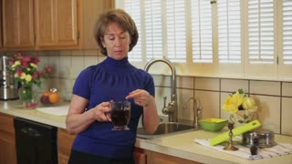 woman making tea and talking