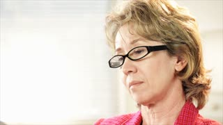 woman office worker looks at camera