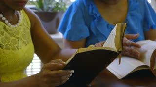 woman reading a bible intently