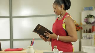 woman small business owner reads her bible