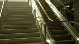 woman walking up stairs at a mall 4k