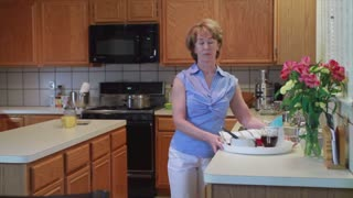 woman with tray in kitchen