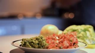 woman preparing tacos