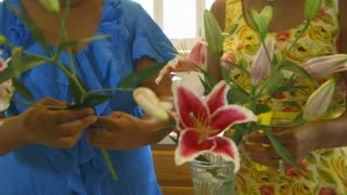 women arranging flowers in her home