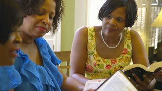 Women listen to bible reading.