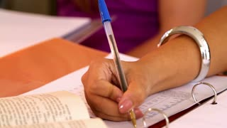 closeup of woman Writing with a pen