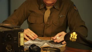 WWII army air corps captain going over photographs