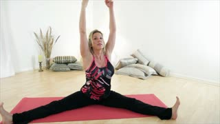 yoga instructor lengthen and stretch warm up