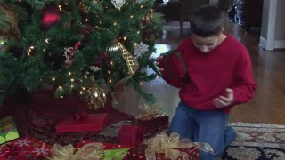 young boy checking presents