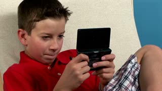 young boy playing with a video game