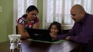 Young family using a laptop pc