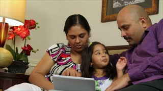 Young family using a tablet pc