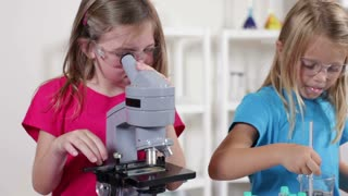 young scientist looking in a microscope.