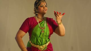 young woman dancing to traditional Indian music