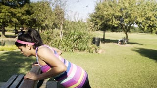 Young woman exercising in a park hurts her wrist 4k