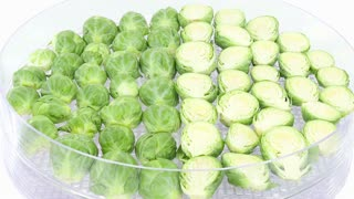 Time-lapse of drying Brussels sprouts in dehydrating machine 1a2 in 4K format on white background