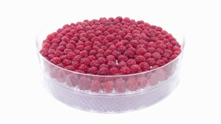 Time-lapse of drying raspberry in dehydration machine 1x2 4K format on white background