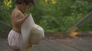 Happy African-American baby first steps
