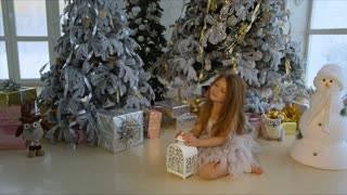 Happy little girl at Christmas tree