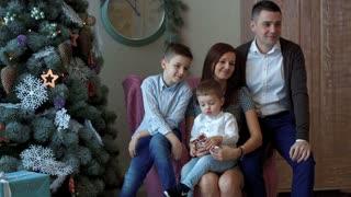 Happy family at the New Year tree