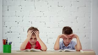 Students read a book in class